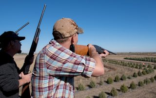 Men Shooting clays at Longmeadow Game Resort, Event Center, And Clays Club
