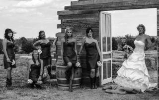 bride and her maids taking a wedding photo
