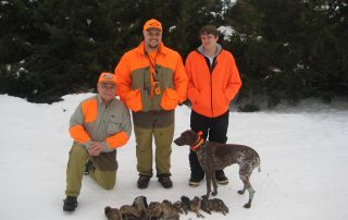 dog and hunters after pheasant hunting
