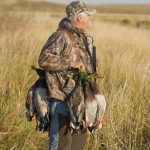 A man with his catch, colorado duck hunting