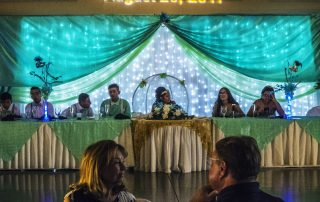 quinceanera party sitting at at table