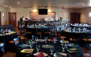 a dinning room set and ready for a party at longmeadow corporate event center - Colorado Event Center