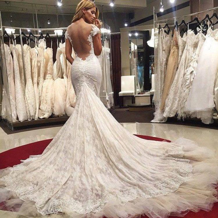 A beautiful bride in a stunning wedding dress - Sexiest Wedding Dresses 2019