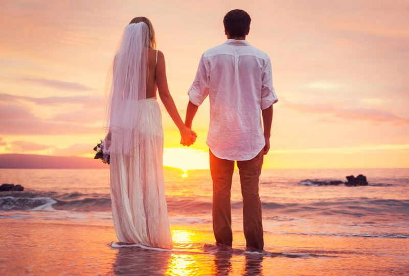 Bride and Groom, Enjoying Amazing Sunset on a Beautiful Tropical Beach, Romantic Married Couple