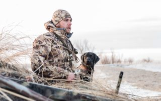 man and his dog duck hunting at longmeadow game resort