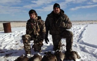 father ans sun at longmeadow after goose hunting