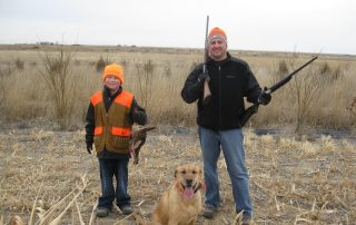 father and son with dog before pheasant hunting - SITKA gear at Longmeadow
