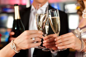 A photo of a wedding toast with three glasses of champagne