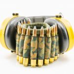 yellow ear protection and camouflage ammunition belt for rifle