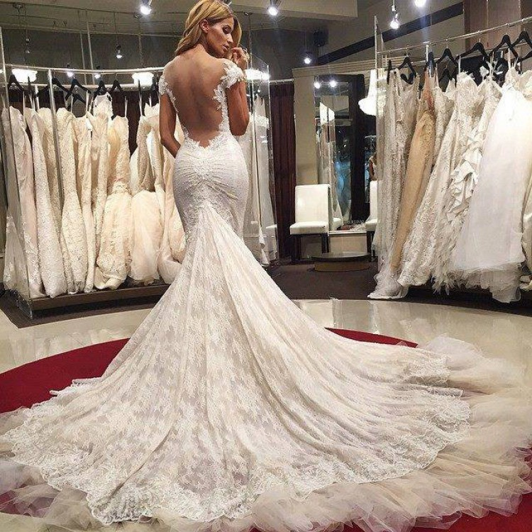 A beautiful bride in a stunning wedding dress - Sexiest Wedding Dresses 2019